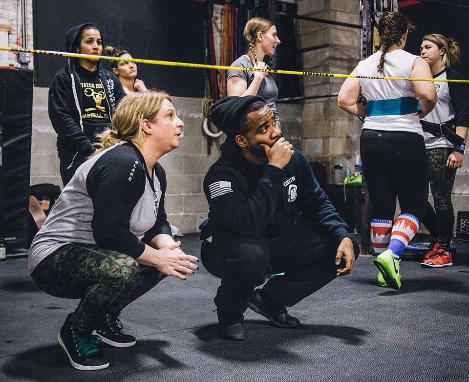 Crossfit Prospect Heights owner and trainer Maillard Howel working with student Lorin Blake.